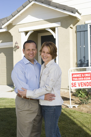 Mid-adult couple in front of new house, portrait Stock Photo - 5475482