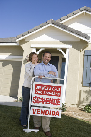 Mid-adult couple in front of new house, portrait Stock Photo - 5475489