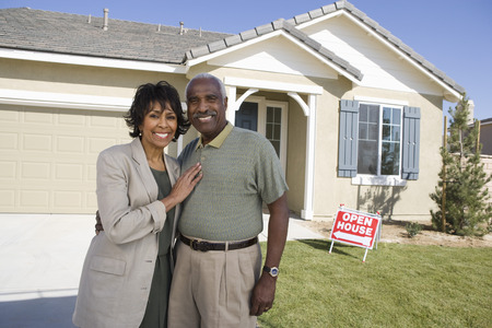 Mid-adult couple in front of new house, portrait Stock Photo - 5475503