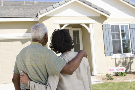 Middle-aged couple looking at house, back view Stock Photo - 5475505