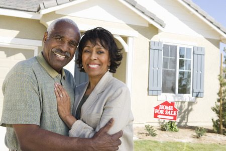 Mid-adult couple in front of new house, portrait Stock Photo - 5475507