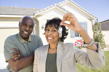 Portrait of middle-aged couple with keys to new house Stock Photo - 5475508