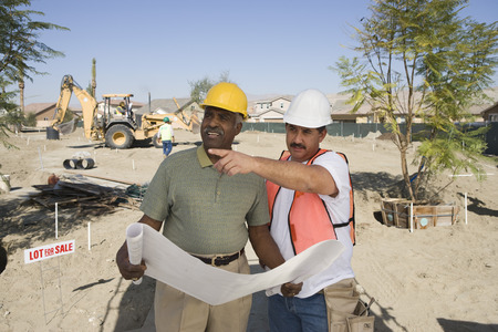 Surveyor and contraction worker at construction site Stock Photo - 5475513