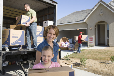Portrait of family with daughter (7-9) unloading truck Stock Photo - 5475521