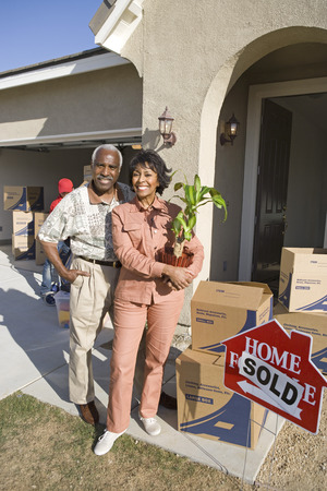 Middle-aged couple in front of new house Stock Photo - 5475533