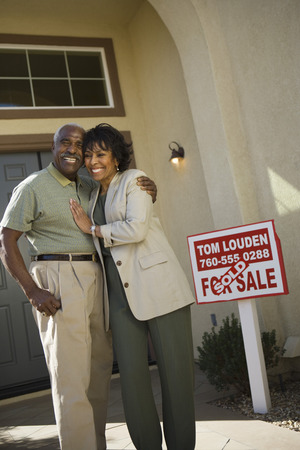 Middle-aged couple in front of new home Stock Photo - 5412246