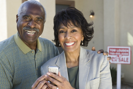 Middle-aged couple in front of new home Stock Photo - 5412257