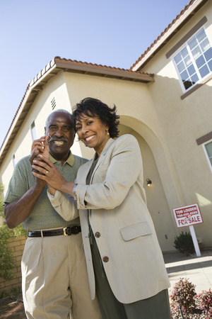 Portrait of middle-aged couple with key to new home Stock Photo - 5475547