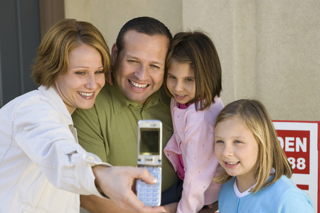 middle easterners: Family with two children (6-9) photographing with mobile LANG_EVOIMAGES
