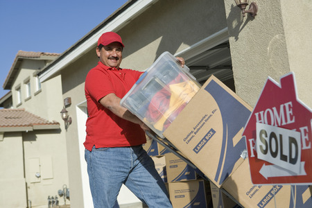 middle easterners: Portrait of mid-adult man moving into house