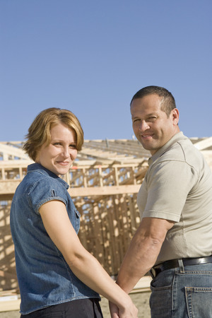 middle easterners: Mid-adult couple at construction site, portrait