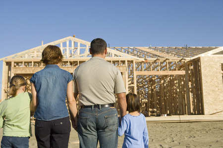 middle easterners: Family with two children (6-9) at construction site, back view