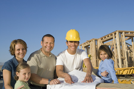 middle easterners: Portrait of family with two children (6-9) and construction side manager