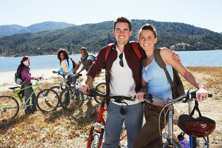 mountain bicycling: Young Couple Mountain Biking with Friends LANG_EVOIMAGES