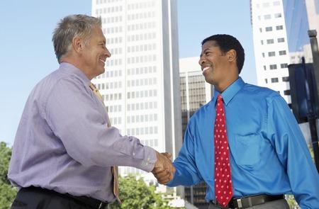 deal making: Businessmen Shaking Hands LANG_EVOIMAGES