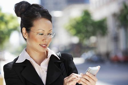 Businesswoman Using PDA Stock Photo - 5475579