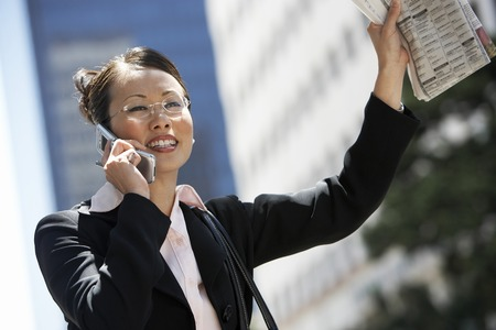 hailing: Businesswoman Hailing Taxi LANG_EVOIMAGES