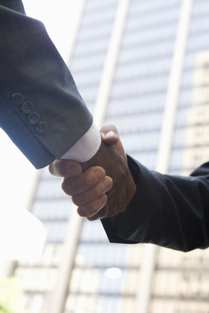 Close-up of businessmen handshake, outdoors Stock Photo - 5475584