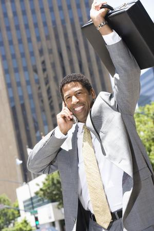 Businessman celebrating at street Stock Photo - 5475589