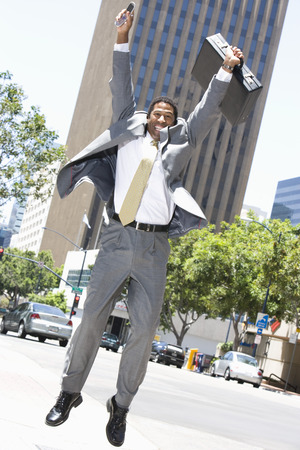 female likeness: Businessman jumping at street