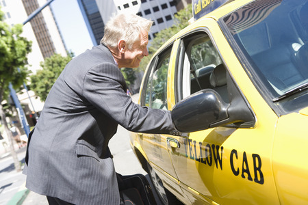 Businessman talking to taxi driver Stock Photo - 5475591