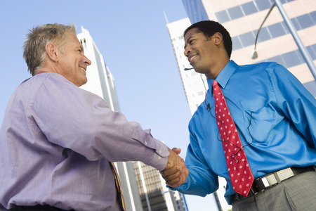 Two businessmen shaking hands, outdoors Stock Photo - 5475593