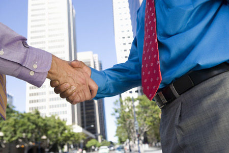 Close-up of businessmen handshake, outdoors Stock Photo - 5475594