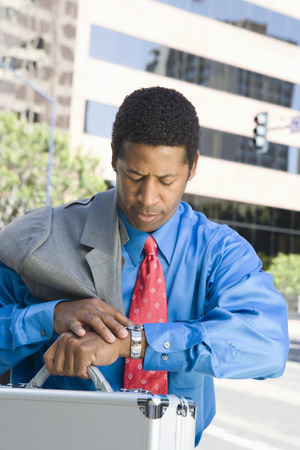 Mid-adult businessman checking time Stock Photo - 5475599