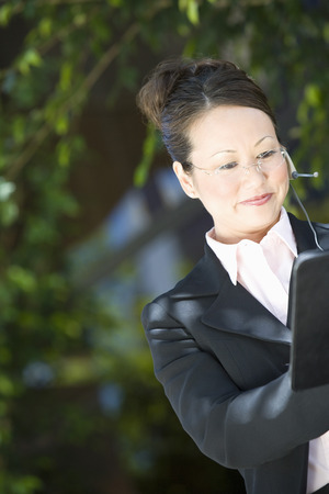 Young business woman with diary, outdoors Stock Photo - 5475615