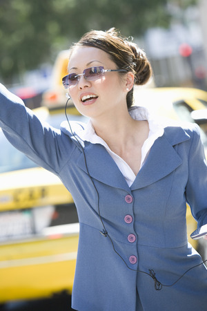 hailing: Businesswoman Hailing a Cab LANG_EVOIMAGES
