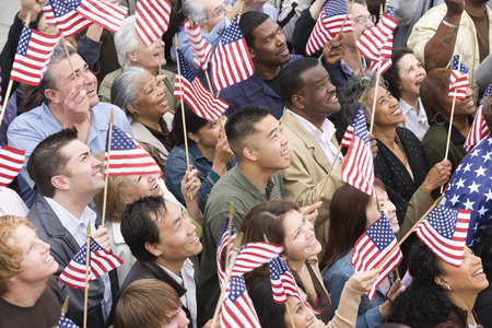 winning flag: Crowd holding American flags LANG_EVOIMAGES