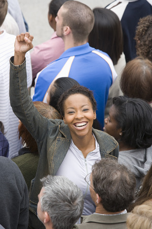 Woman with arm raised in crowd Stock Photo - 5475644