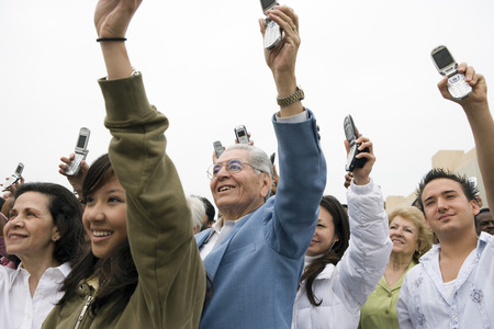 Crowd holding up mobile phones Stock Photo - 5475656