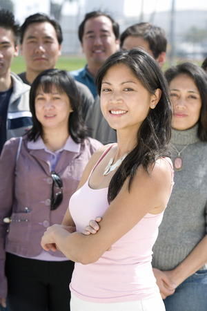 Young woman standing in crowd Stock Photo - 5475672