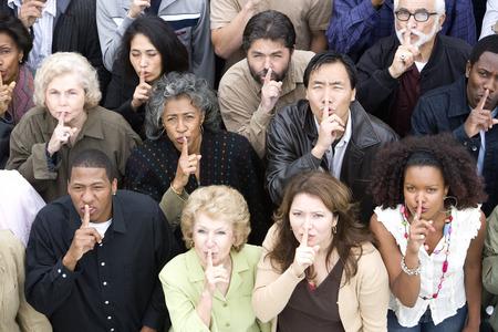 mixed age range: Gesturing de multitud de silencio