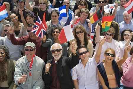 mixed age range: Multitud levantando las banderas nacionales LANG_EVOIMAGES