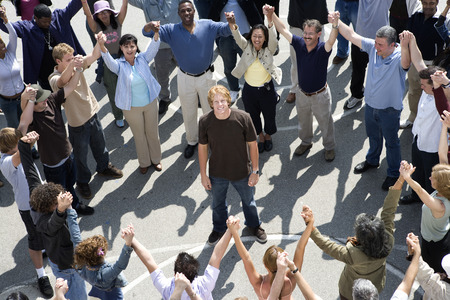 Crowd with arms raised surrounding young man Stock Photo - 5475711