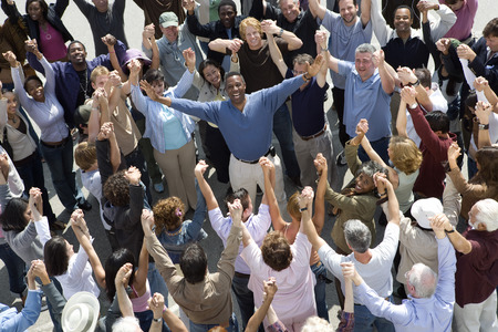 Crowd with arms raised surrounding man Stock Photo - 5475712
