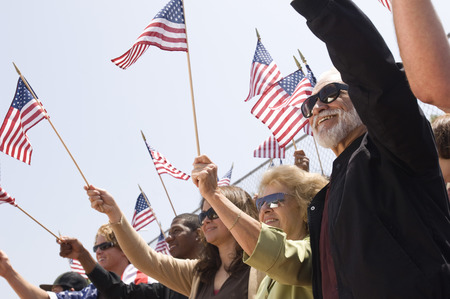 american flags: Crowd holding American flags LANG_EVOIMAGES