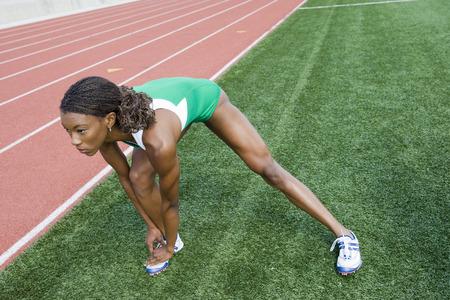 jambes �cart�es: Athl�te f�minine �tirement