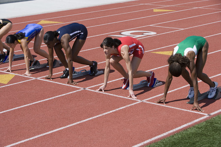 Female athletes in starting blocks, ready to run Stock Photo - 5475885