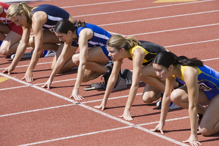 Female athletes in starting blocks, ready to run Stock Photo - 5475886