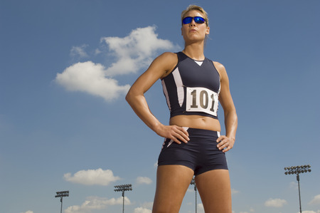 Female track athlete standing on track Stock Photo - 5475988
