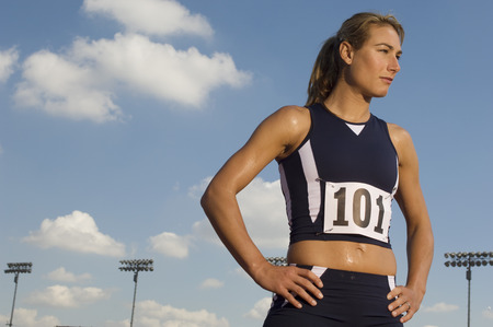Female track athlete standing on track Stock Photo - 5475990