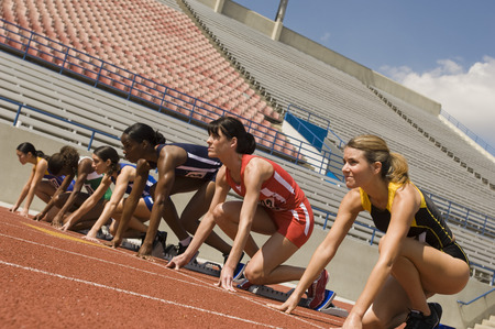 Group of female track athletes on starting blocks Stock Photo - 5475998