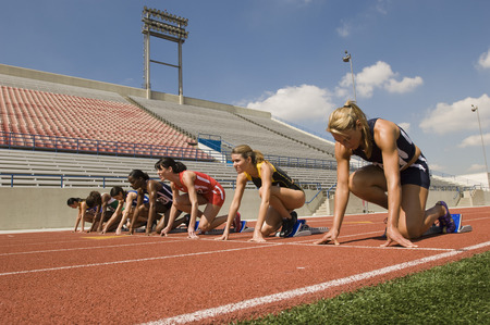 Group of female track athletes on starting blocks Stock Photo - 5475999
