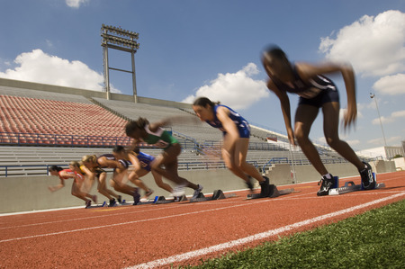 Group of female track athletes sprinting Stock Photo - 5476007