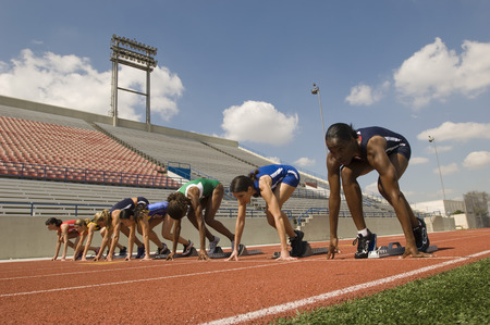 Group of female track athletes on starting blocks Stock Photo - 5476008