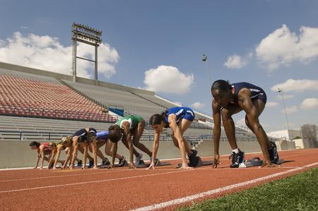 Group of female track athletes on starting blocks Stock Photo - 5476008