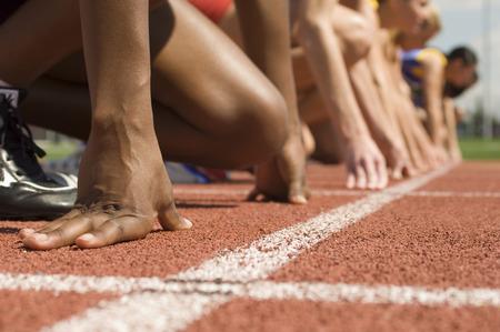 Group of female track athletes on starting blocks Stock Photo - 5476010